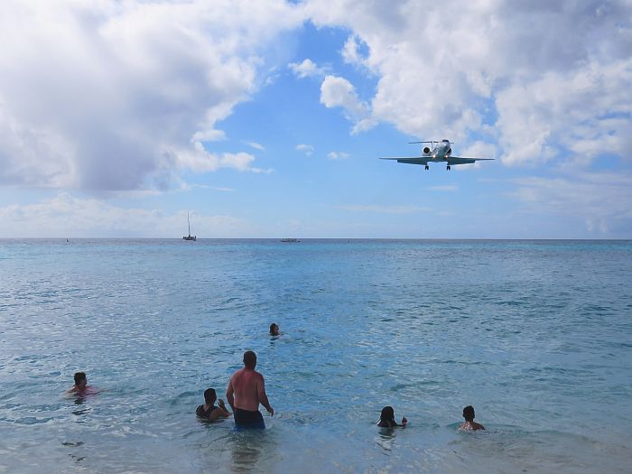 Plane coming into land at maho beach, st. maarten